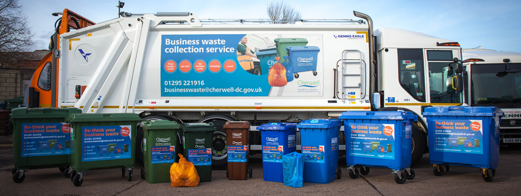 Cherwell refuse collection vehicle with a selection of commercial waste and recycling bins