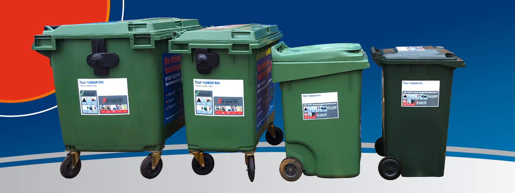 Row of four green general waste bins of various sizes