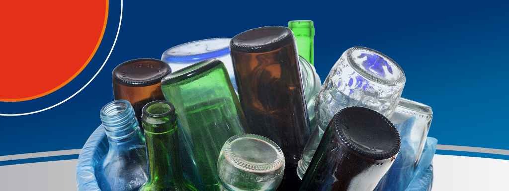 Glass bottles in a container ready for recycling collection